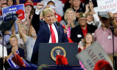 Photo of President Donald Trump acknowledges a crowd at a rally
