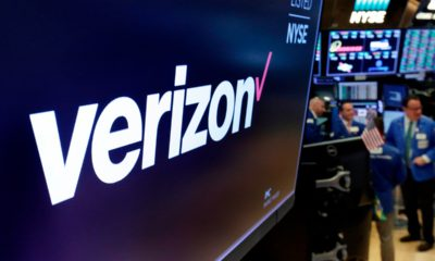 Photo of the logo for Verizon above a trading post on the floor of the New York Stock Exchange