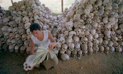 Photo of a man cleaning skulls