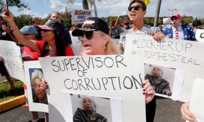 Photo of a crowd protesting outside the Broward County Supervisor of Elections office