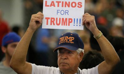 Photo of a man holding up a sign for President Donald Trump