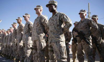 Photo of U.S. Marines standing guard
