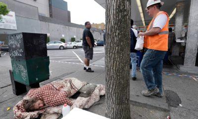 Photo of a man sleeping on the sidewalk in Seattle, WA