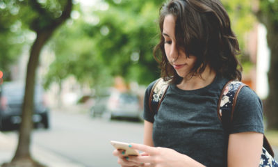Photo of a woman checking her smartphone for messages