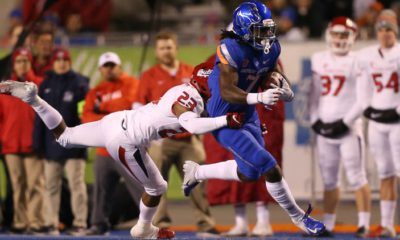 Photo of a Fresno State player tackling a Boise State player