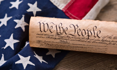 Photo of US Flag and Constitution