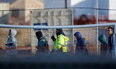 Photo of teen migrants walking in a line