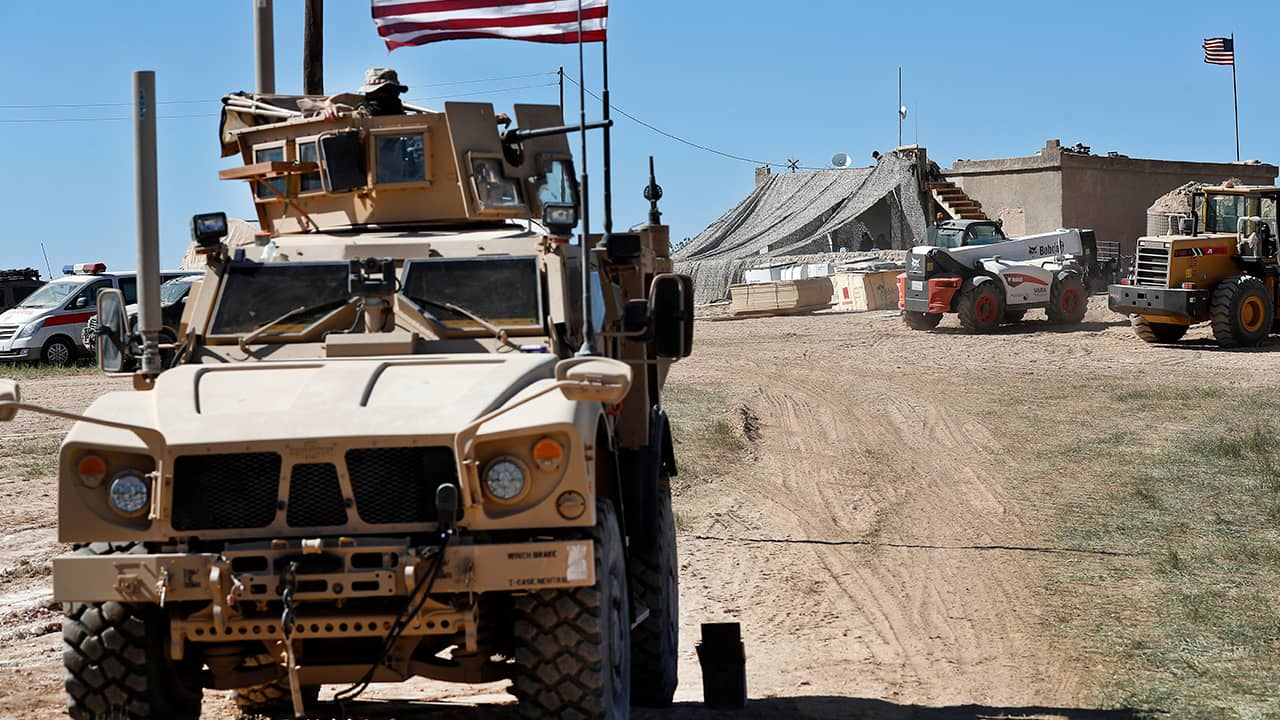 Photo of a US soldier sitting in an armored vehicle
