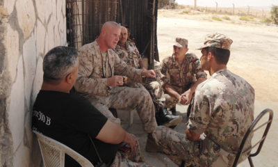 Photo of Marine officer Terry Slatic with his troops in Afghanistan