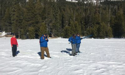 Photo of first Sierra snowpack measurement of 2019