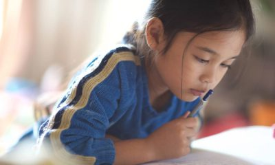Photo of Asian American girl reading