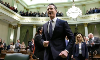 Gov. Gavin Newsom enters the Capitol chamber
