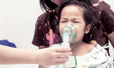 Photo of child with inhaler mask