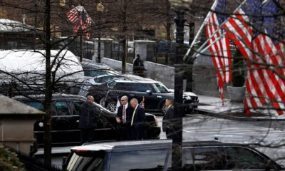 Photo of Secret Service Agents stand by the limo of VP Mike Pence