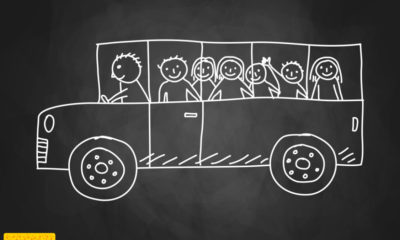 chalkboard drawing of a school bus filled with kids