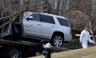 Photo of crime investigators loading a car