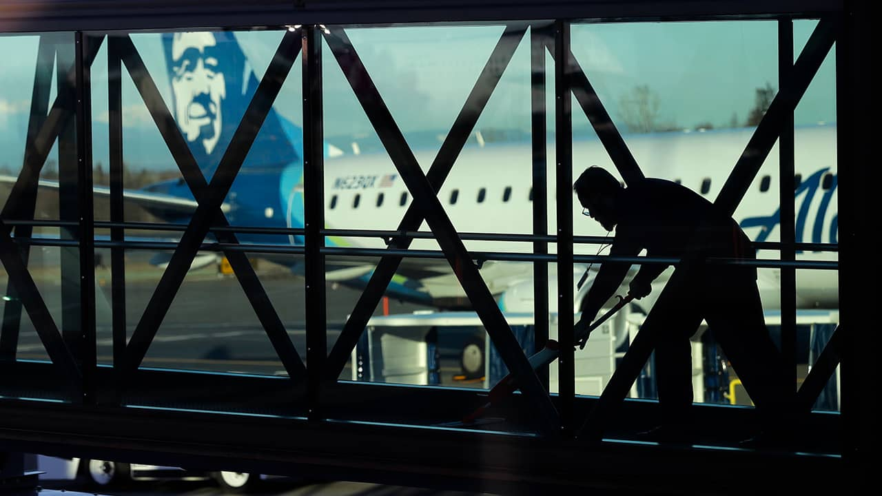 Photo of worker cleaning a jet bridge