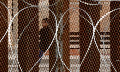 Photo of razor wire covered border wall