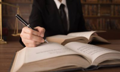 Photo of man writing legislation