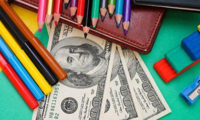Photo of school supplies and hundred dollar bills