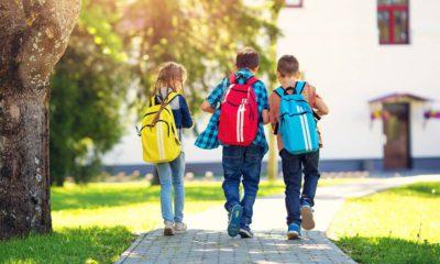 Photo of 3 children walking to school