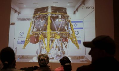 Photo of people watching a live broadcast of the SpaceL spacecraft