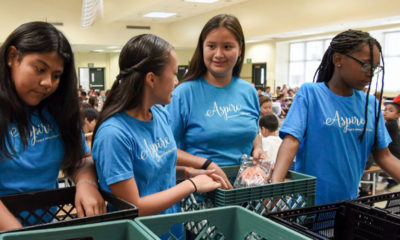 Fresno Unified students collect surplus food from the cafeteria after lunch as part of the district's Food to Share partnership.