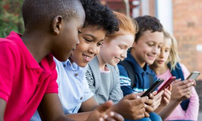 Photo of children on their cell phones