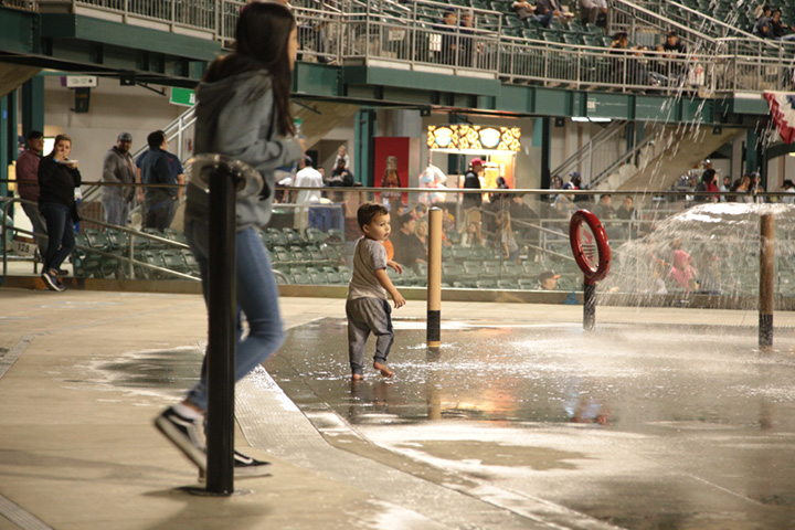 A young fan enjoys the new Splash Park  at Opening Night at Chukchansi Park in Fresno on April 4, 2019 (GV Wire/Jahz Tello)
