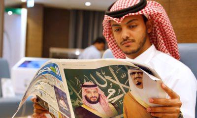 Photo of a man reading a newspaper in Mecca, Saudi Arabia