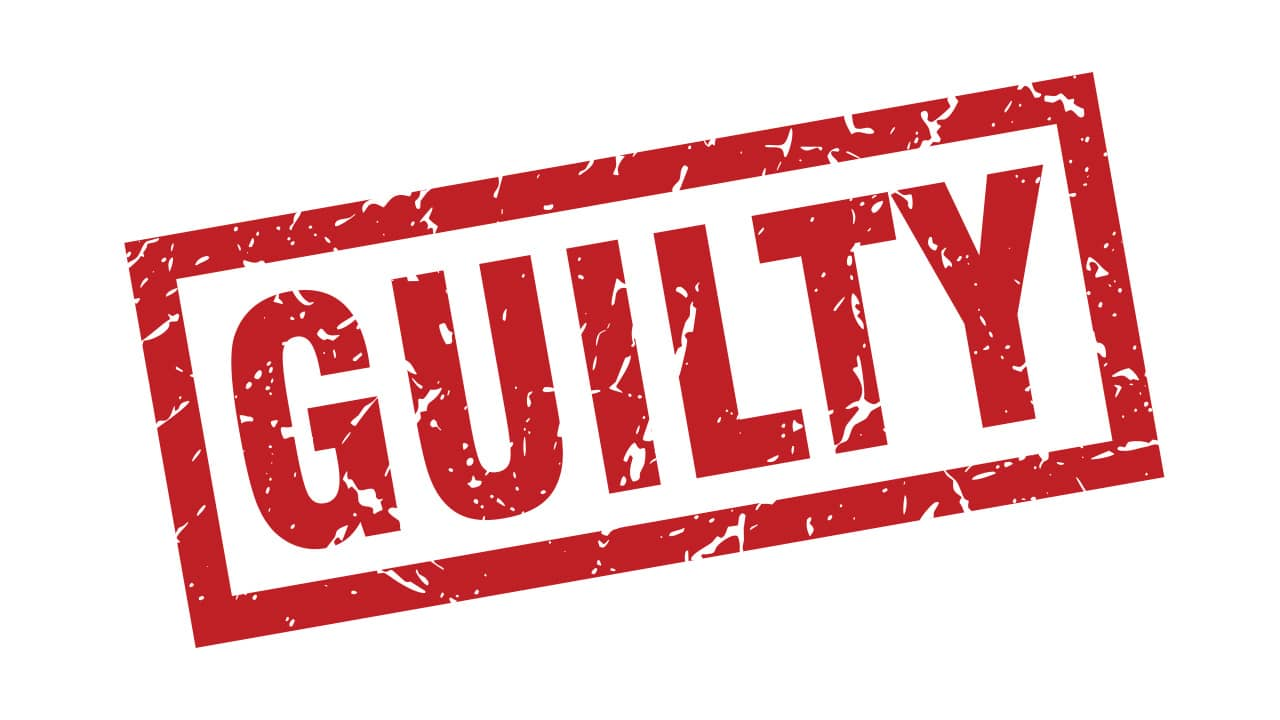 A red and white sign that says Guilty