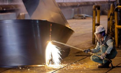 Photo of Iranian worker cutting a steel roll