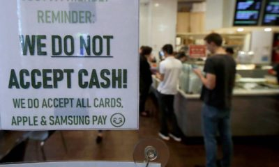 Photo of a sign informing customers that cash is not accepted