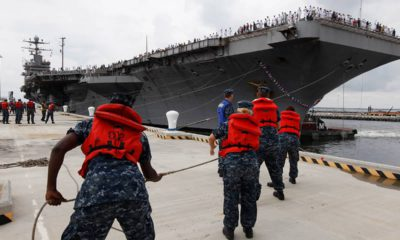 Photo of Navy shore crew hauling in lines