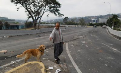 Photo of a man walking his dog in Venezuela