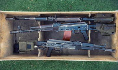 photo of three machine guns in a box