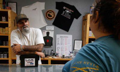 Photo of gun shop owner and customer