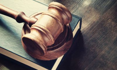 Photo of a judge's gavel and book