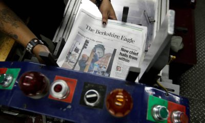 Photo of The Berkshire Eagle newspapers being placed in a machine