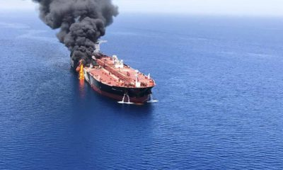 Photo of oil tanker on fire in the sea of Oman