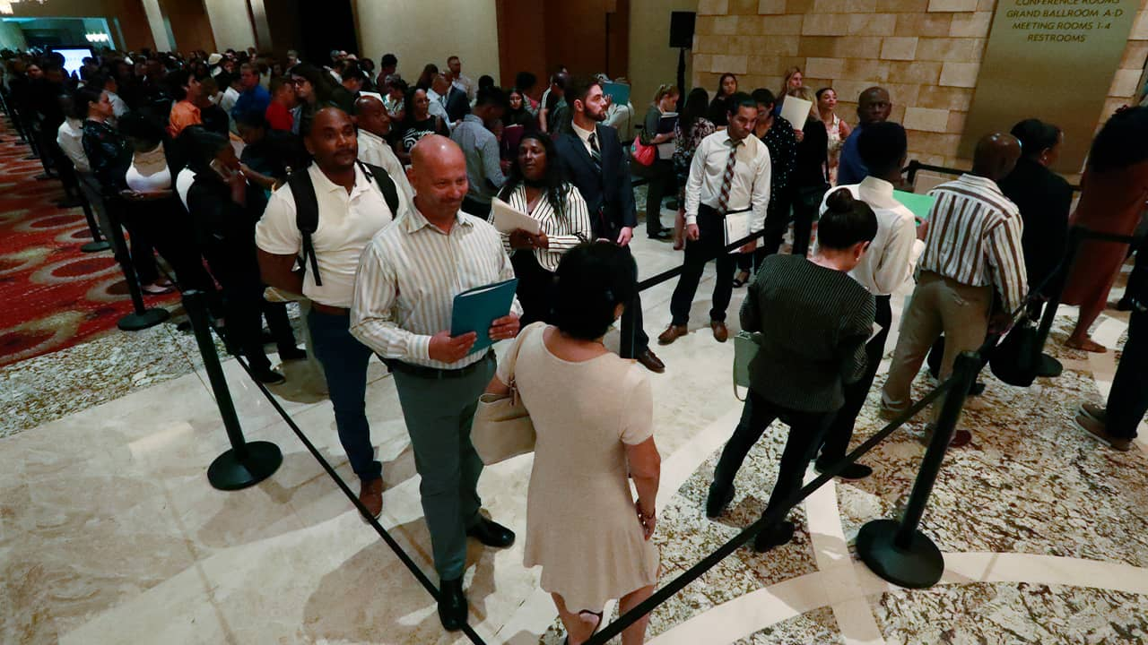 Photo of job applicants lined up during a job fair in Hollywood, Fla.