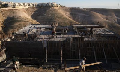 Photo of Palestinian laborers at a construction site