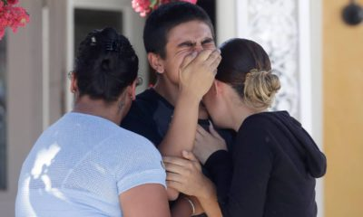 Photo of Joshua Guicho, 16, center, crying between his aunts Josephine Guicho, left, and Erica Guicho