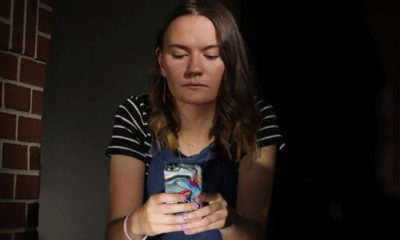Photo of Rachel Wilson looking at her phone