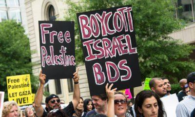 Photo of demonstrators in Washington, D.C., urging a boycott of Israel