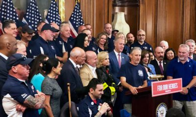 Photo of Jon Stewart speaking at a news conference on behalf of 9/11 victims