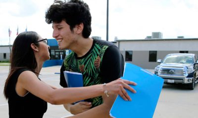 Photo of U.S. citizen Francisco Galicia, 18, getting a hug from his attorney