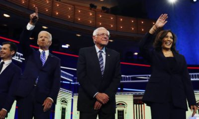 Photo of Democratic presidential candidates before the start of the Democratic primary debate