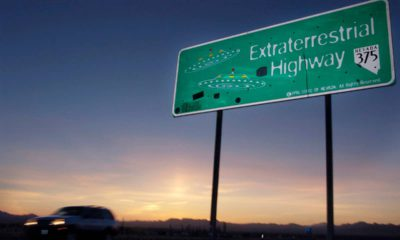 Photo of a car moving along the Extraterrestrial Highway