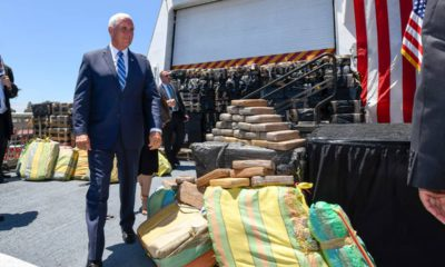 Photo of VP Mike Pence and bales of seized cocaine